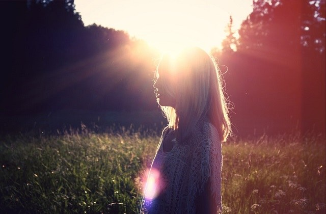 woman in the field with sunshine