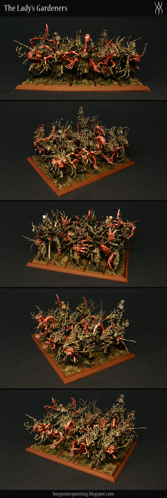 20 converted Sylvaneth Dryads on square bases - with their faces replaced with a sigil and with plenty of greenstuff and bits used to add red, fleshy tendrils, mouths, random limbs and spikes, creating a grimdark, AoS28 version of them. Here they are shown as a whole unit on a tray, from several angles, slightly above. They are usable in WFB or AoS.
