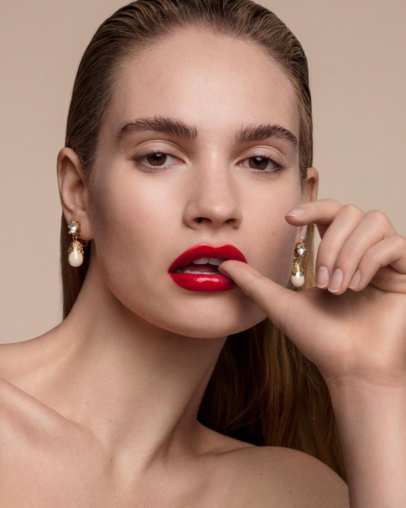 Lily James models Burberry Kisses Lip Lacquer in Military Red