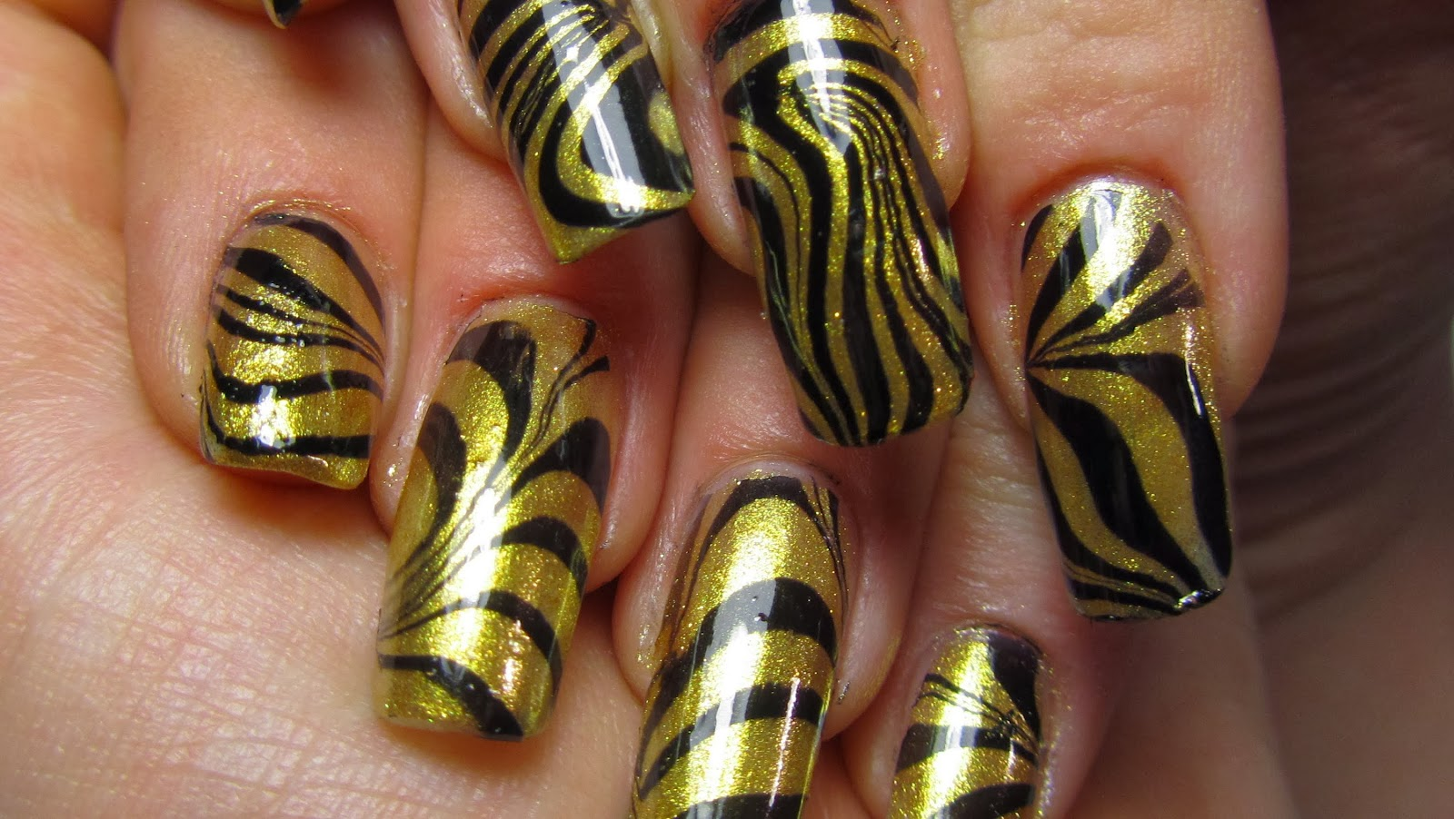 One Hundred Styles: Black and Gold Nail Art Designs