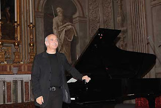 Ludovico Einaudi takes the applause after a  performance at the Palazzo del Quirinale