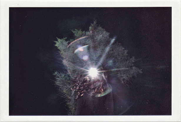 dirty photos - a - dark double exposure photo of girl with light hole