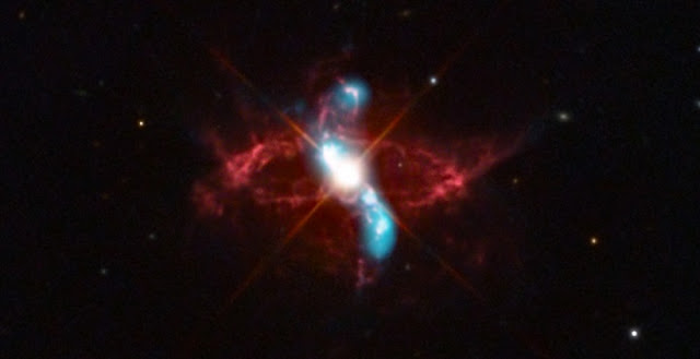 Since shortly after Chandra launched in 1999, astronomers began using the X-ray telescope to monitor the behavior of R Aqr, giving them a better understanding of the behavior of R Aqr in more recent years. Chandra data (blue) in this composite reveal a jet of X-ray emission that extends to the upper left. The X-rays have likely been generated by shock waves, similar to sonic booms around supersonic planes, caused by the jet striking surrounding material. Credit: X-ray: NASA/CXC/SAO/R. Montez et al.; Optical: Adam Block/Mt. Lemmon SkyCenter/U. Arizona