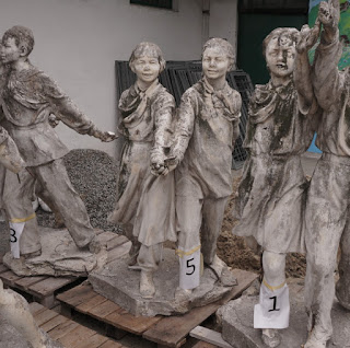 Dismantled figures of an old sculpture 6