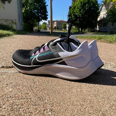 Pair of Nike Pegasus 38 on the sidewalk