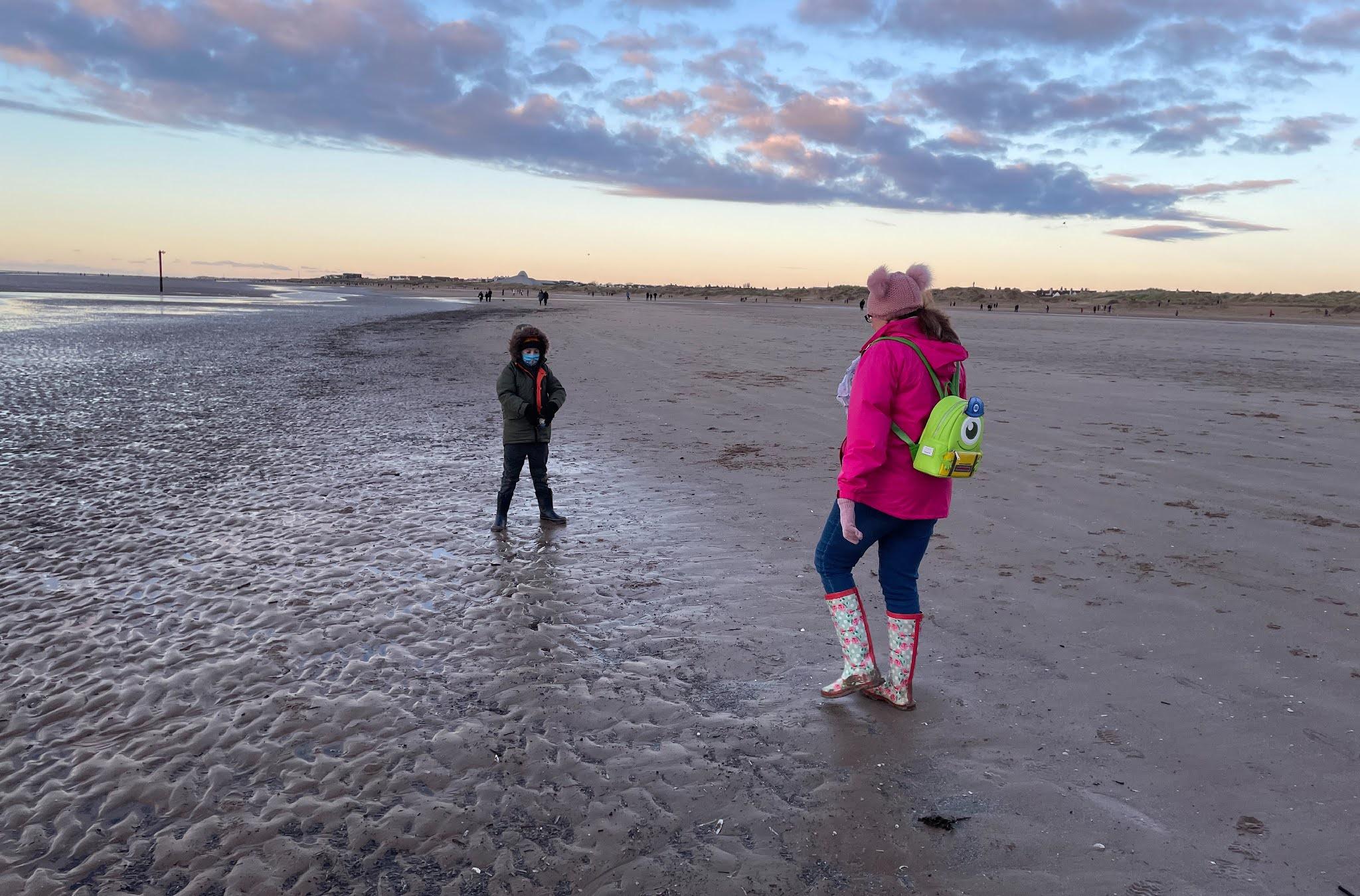 Woman and boy on beach