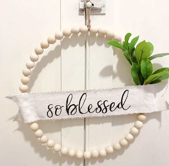 so blessed beaded banner wreath with greens