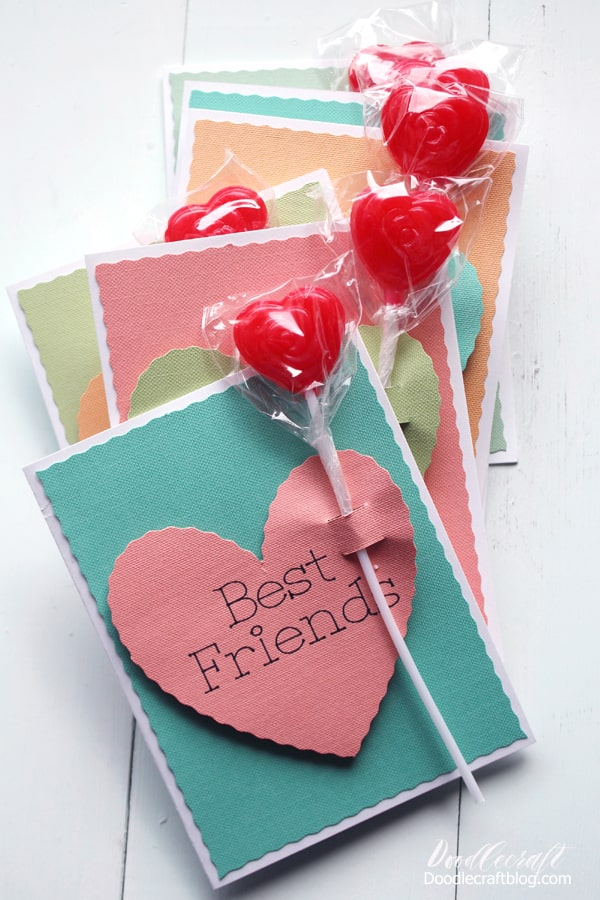 This cute Valentine Card inspired by conversation hearts is easy to make using the Cricut Maker, drawing pen and the wavy cut blade. Insert a lollipop for the perfect Valentine's Day gift!