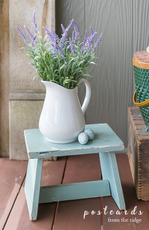 white stoneware pitcher with faux lavender on blue stepstool