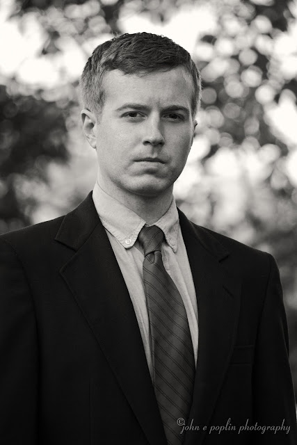 Professional black and white portrait photo of a young man