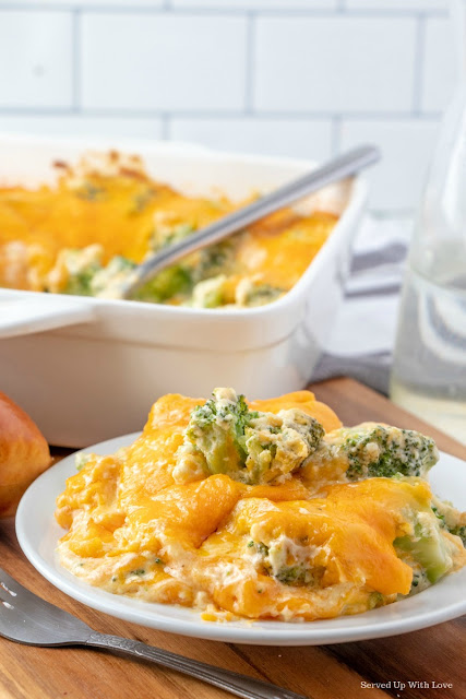Cheese Broccoli Casserole recipe on white plate with silver fork