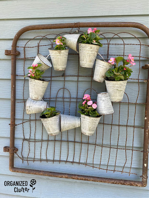 Photo of a galvanized pot wreath with begonias.