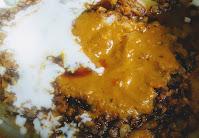 Fried onion paste , beaten curd with masala in pan for veg biryani recipe