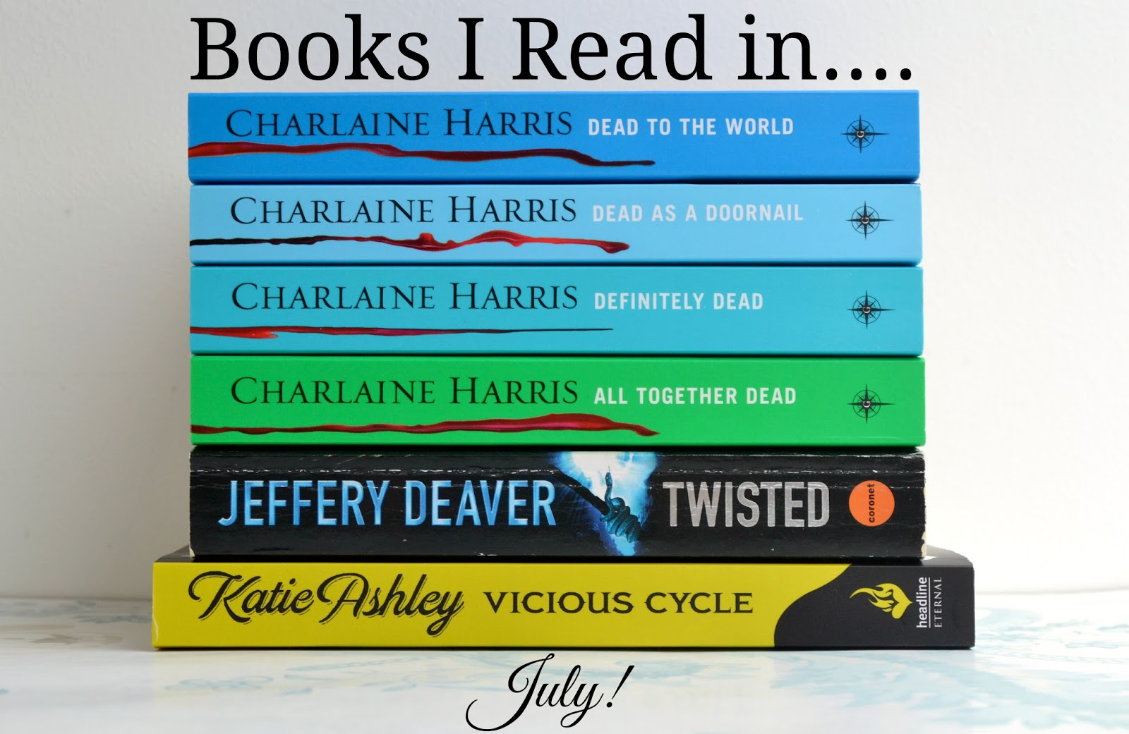 Pile of books including Dead to the World, Dead as a Doornail, Definitely Dead and All Together Dead by Charlaine Harris, Twisted by Jeffery Deaver and Vicious Cycle by Katie Ashley.