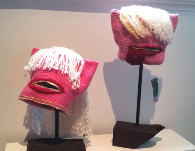 A Millania and Donald Trump themed pair of Pussyhats. Millania is on the left and Donald on the right.