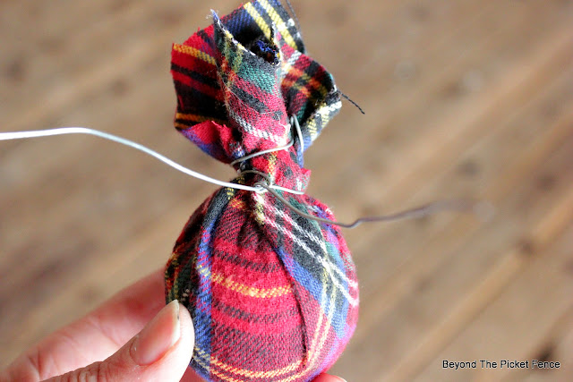 wrap wire around the neck of the christmas ball