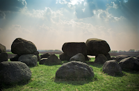Big boulder like rocks randomly lying around on grass