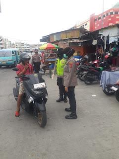 Kasat Binmas Polres Pelabuhan Pimpin Polwan Lakukan Imbauan Prokes