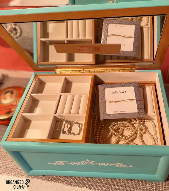 Photo of the inside of a Goodwill jewelry box