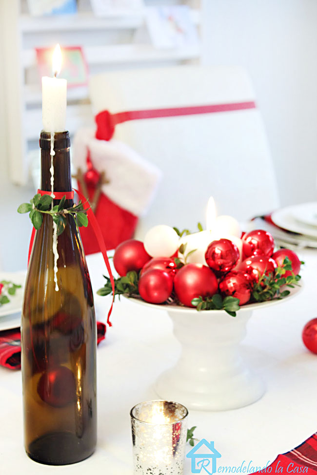 Upcycled green wine bottle as candle holder in Christmas table