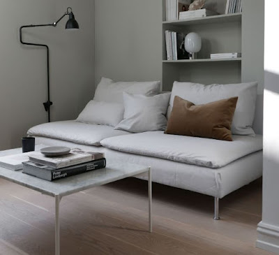 White couch with pillows for perfect apartment living room seating