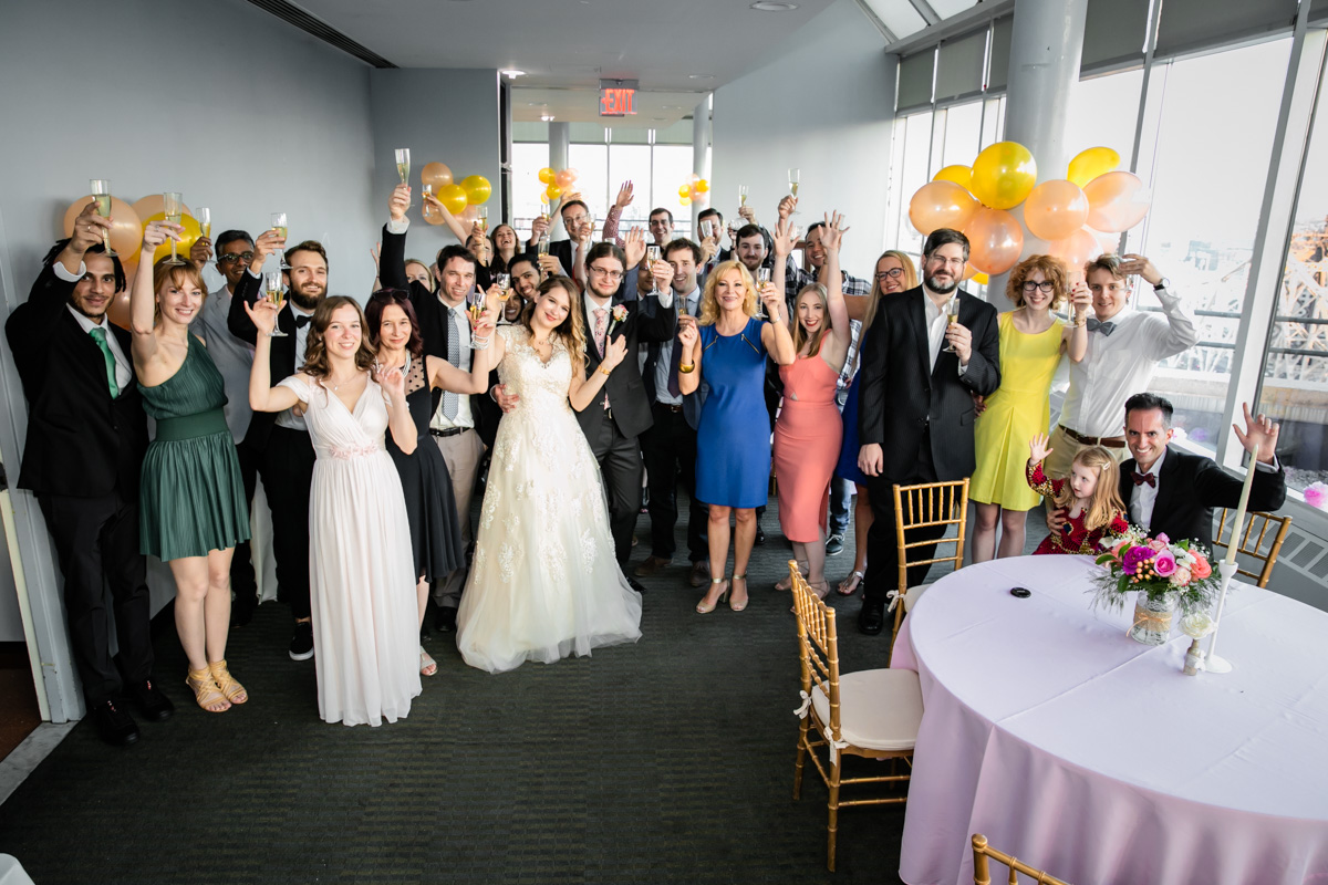 Couple and Guests Share A Toast.