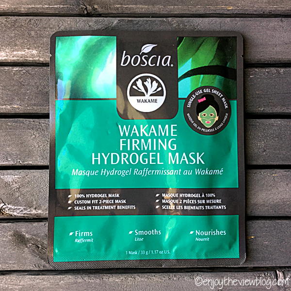 Front of the boscia Wakame Firming Hydrogel Mask package displayed on a wooden table