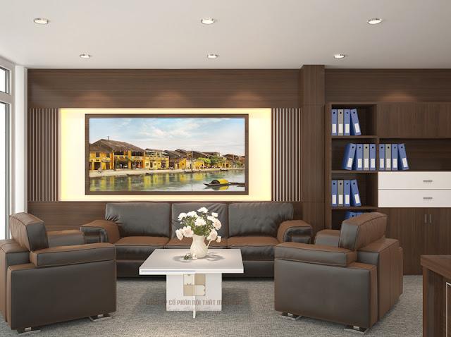 Khu vực tiếp khách trong thiết kế phòng giám đốc sang trọng được bố trí bộ ghế sofa bọc da nâu cực ấn tượng