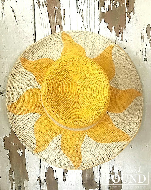 wreaths,re-purposing,up-cycling,summer,diy decorating,DIY,art,art class,wall art,decorating,dollar store crafts,on the porch,outdoors,painting,thrifted,door hangers,door decor,straw hat crafts,straw hat wreath,boho hat,sunhat,summer home decor, summer decorating,diy summer decor.