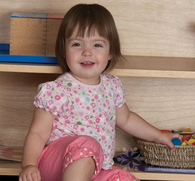 namc montessori developing independence in toddlers girl with low shelf limited choice