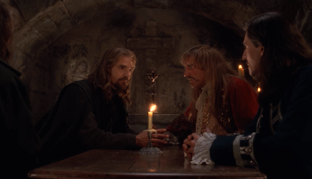 movie The Man in the Iron Mask - secret meeting of musketeers: Athos (John Malkovich), Aramis (Jeremy Irons), Porthos (Gerard Depardieu), and D'Artagnan (Gabriel Byrne)