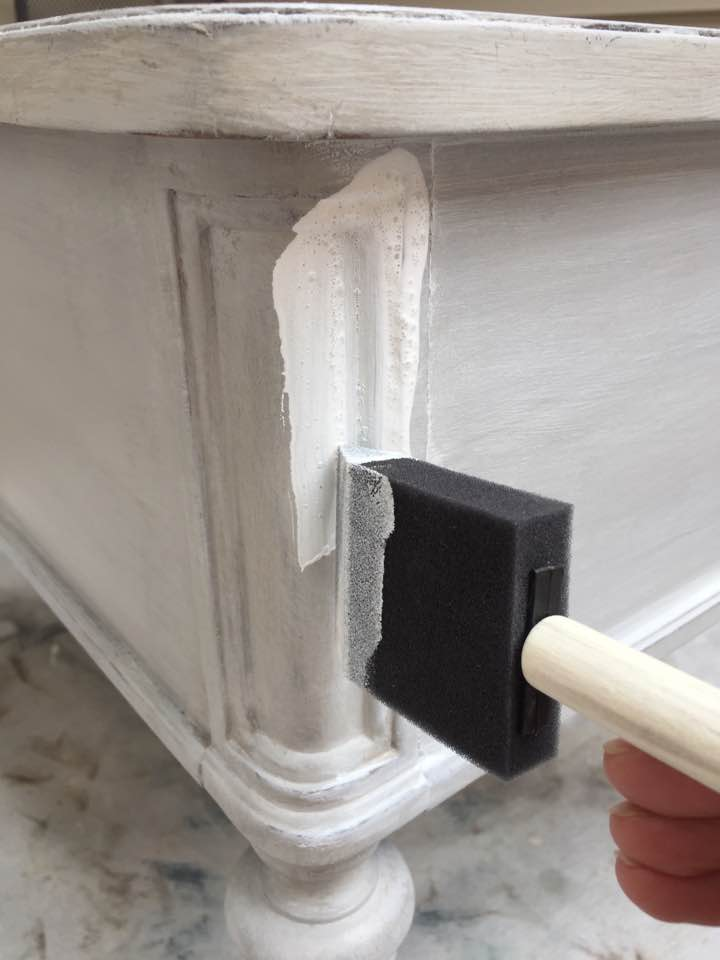 Applying white glaze over the painted finish.