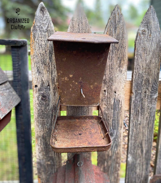 Photo of a vintage rusty bird feeder