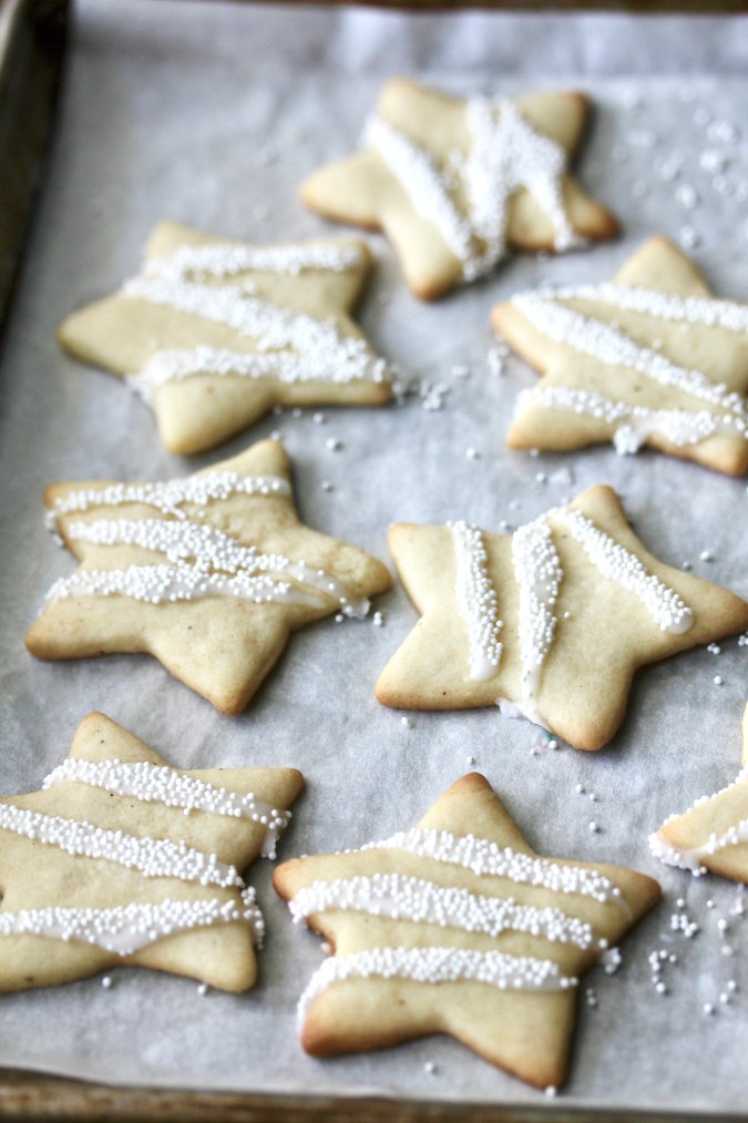Eggnog Cookies Stars with a glaze and nonpareils