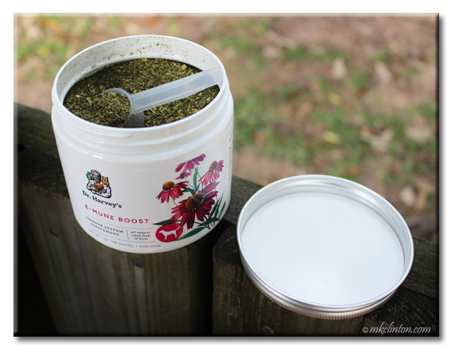 Open canister of Dr. Harvey's E-mune Boost supplement