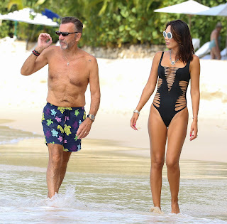 Nigora-Bannatyne-in-an-one-piece-black-swimsuit-at-the-beach-in-Barbados.-q7idk74ton.jpg
