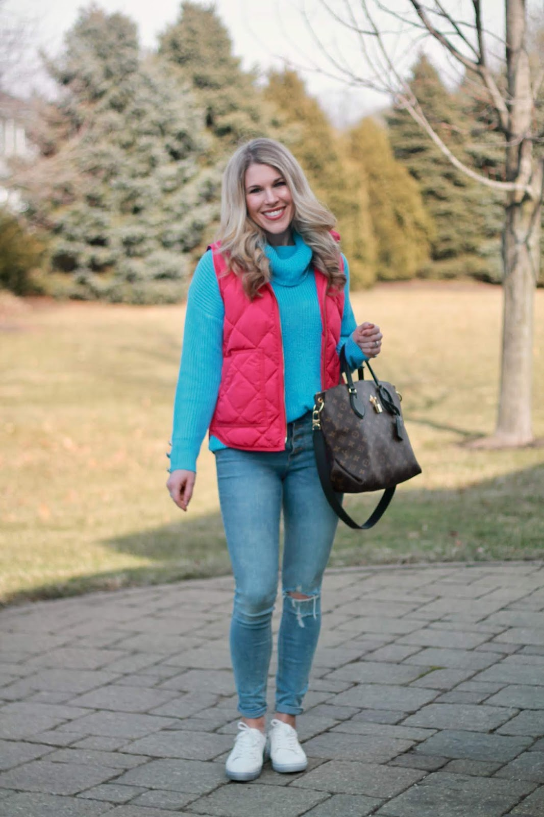 spring casual outfit, distressed jeans, white sneakers, pink vest, light blue sweater, LV flower zippered tote,