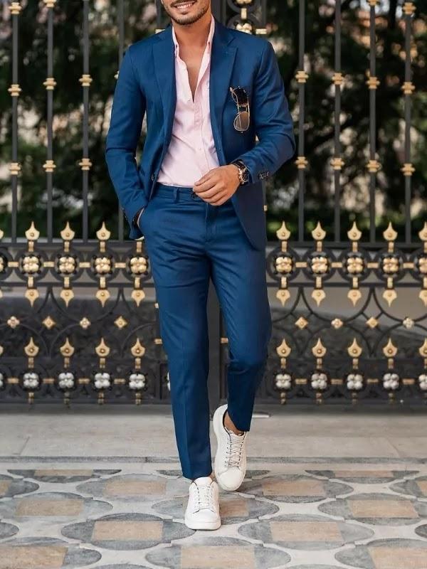 Cobalt blue colour suit with pink shirt.