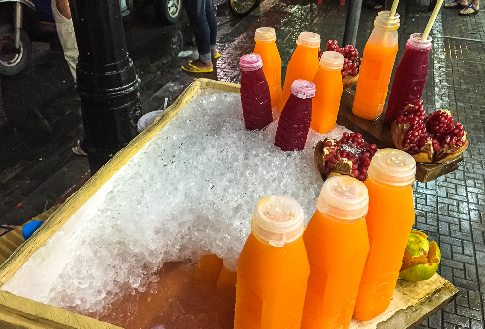 Pomegranate juice and orange juice by the streets in bangkok
