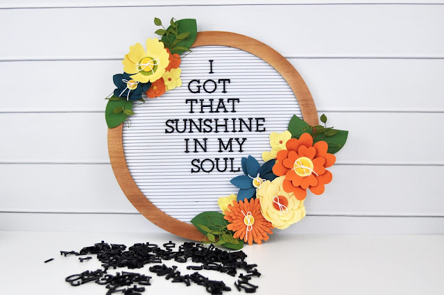 Adding flowers to a letter board by Jen Gallacher for www.jengallacher.com #letterboard #jengallacher #paperflower #dcwv