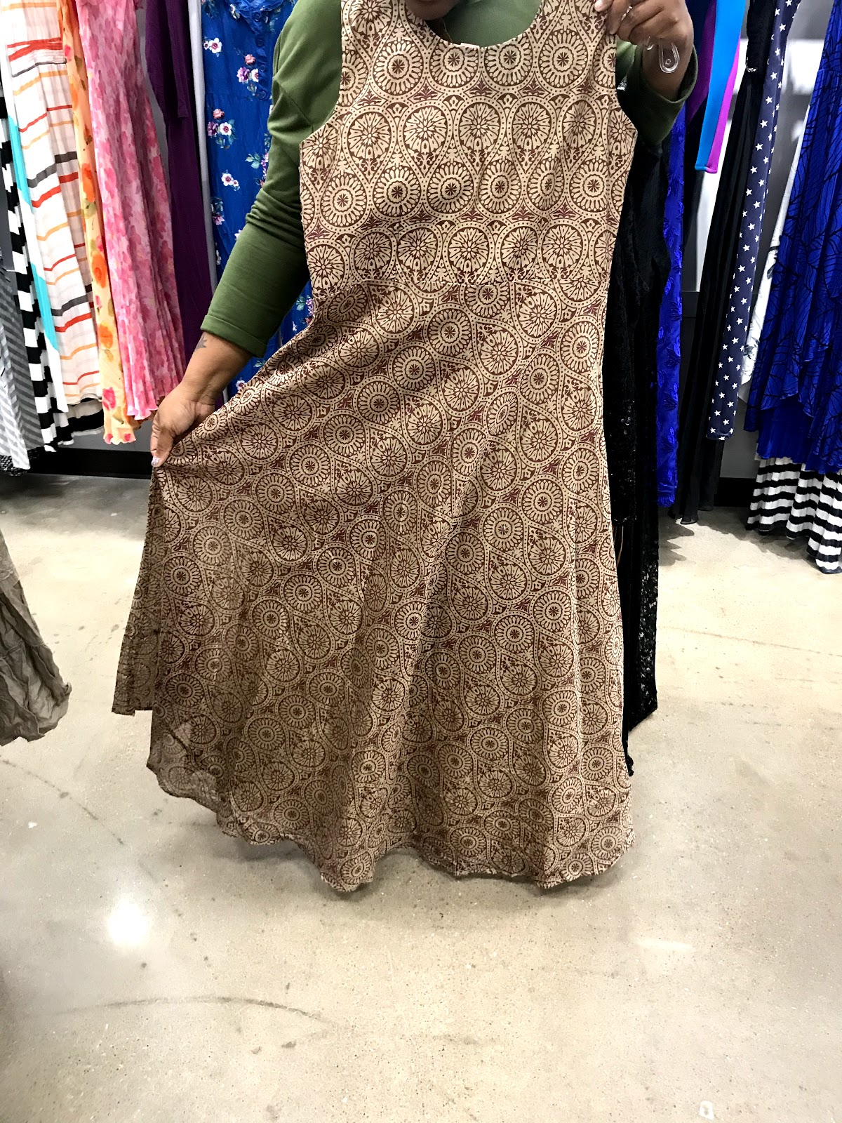 Tangie bell is trying on thrift dresses to buy. You Will Never Guess What I Found At The Thrift Store? And Number Two Is My Jam!