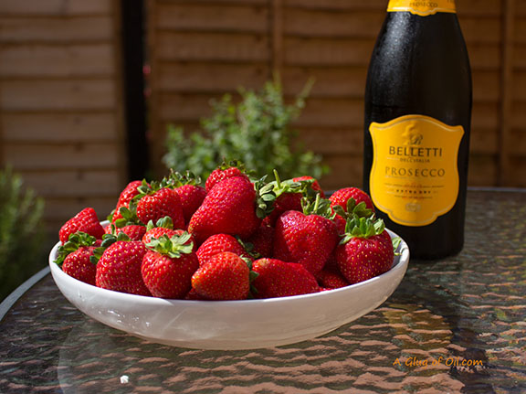 Strawberries with a bottle of Prosecco