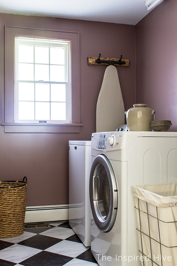 Classic laundry room with plum walls and black and white checkered floors