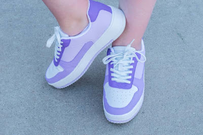 purple and white painted shoes
