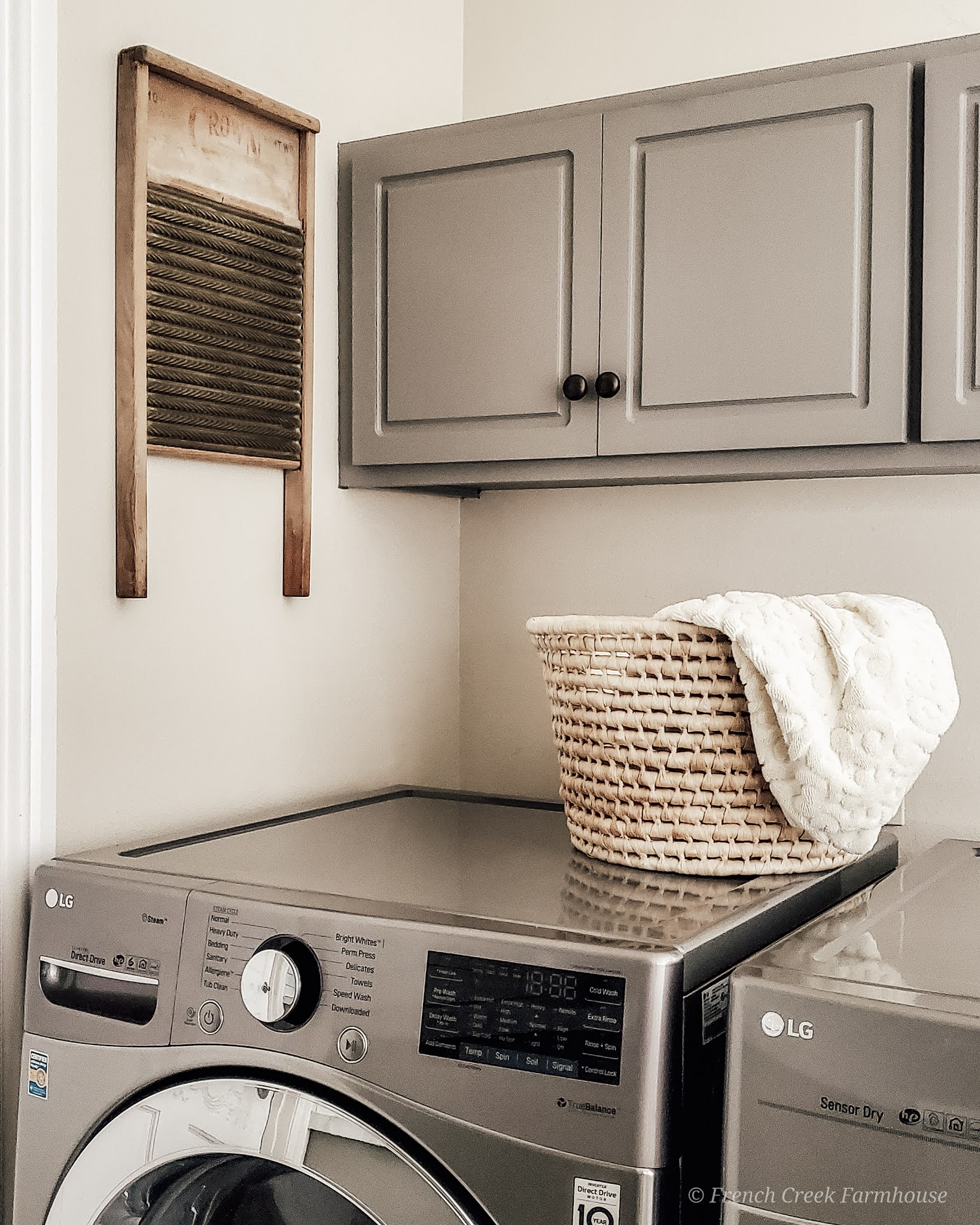 We added a vintage washboard as wall decor to our laundry room