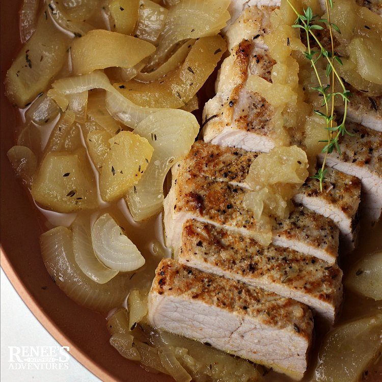 Pork Loin Filet with Apples and Onions by Renee's Kitchen Adventures sliced pork in pan with apples and onions ready to eat, overhead shot