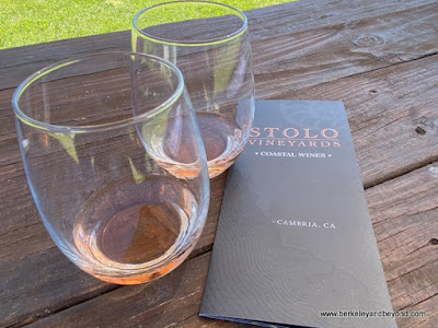 tasting set up at check-in desk at Stolo Family Vineyards in Cambria, California