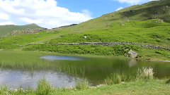 Alcock Tarn on the western side of Heron Pike, overlooking Grasmere in the Lake District