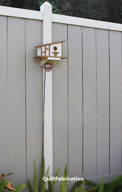 modern cream colored decorative birdhouse