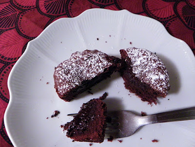 Chocolate Molten Lava Cupcake cut up to reveal molten center